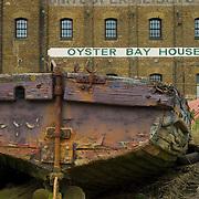 Abandoned barge at Oyster Bay House, Faversham, Kent, England