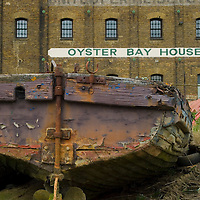 Abandoned barge at Oyster Bay House, Faversham, Kent, England