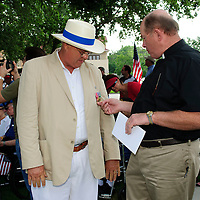 Good Sheperd Episcopal Church Father Jim Nelson talks the medals with Jay M. Horecky, creator of the new Friendswood Veterans Memorial that was dedicated today.