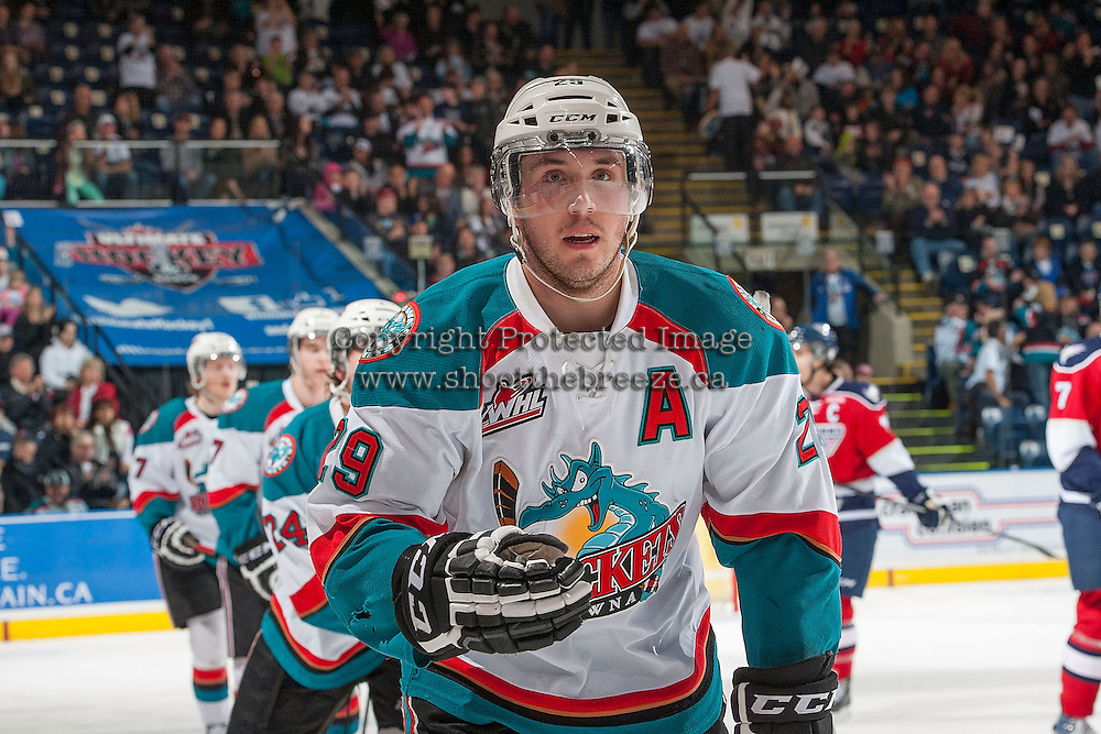 KELOWNA, CANADA - MARCH 23:  Myles Bell #29 of the Kelowna Rockets skates to the bench to celebrate a goal against the Tri-City Americans on March 23, 2014 during game 2 of the first round of WHL Playoffs at Prospera Place in Kelowna, British Columbia, Canada.   (Photo by Marissa Baecker/Getty Images)  *** Local Caption *** Myles Bell;