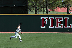 26 April 2014:   Dyllin Mucha tracks down a well hit fly ball and reels it in during an NCAA Division 1 Missouri Valley Conference (MVC) Baseball game between the Southern Illinois Salukis and the Illinois State Redbirds in Duffy Bass Field, Normal IL