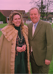MR & MRS WILLIE ROBERTSON the leading music world insurance broker, at a race meeting in Surrey on 24th April 1998.MHB 3