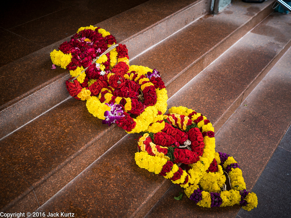27 DECEMBER 2016 - SINGAPORE: A flower garland on the transom at Sri Veeramakaliamman Temple in Singapore. It is one of the most important Hindu temples in Singapore.      PHOTO BY JACK KURTZ