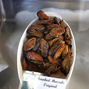 Smoked mussels for sale at The Coromandel Smoking Company, Coromandel Town. New Zealand. 28th November 2010. Photo Tim Clayton..
