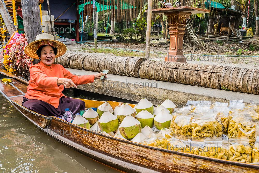 Bangkok, Thailand - December 30, 2013: seller at Amphawa Bangkok floating market at Bangkok, Thailand on december 30th, 2013