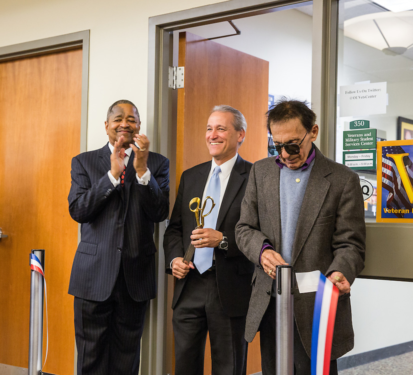 (Left to Right) Ohio University President Roderick McDavis, Danny Abraham and Raymond Abraham participate in the dedication of the Brigadier General James M. Abraham - Colonel Arlene F. Greenfield Veterans and Military Student Services Center. Danny Abraham is General Abraham's son and Raymond Abraham is the General's brother. Photo by Jasmine Beaubien