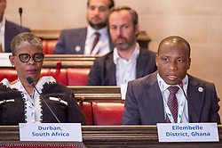 © Licensed to London News Pictures. 22/10/2018. Bristol, UK. Global Parliament of Mayors Annual Summit, 21-23 October 2018, at Bristol City Hall. Picture of KWASI BONZOH, Mayor of Ellembelle District, Ghana, taking part in the plenary session on harnessing the power of migration. The Global Parliament of Mayors 2018 is the biggest and most ambitious Annual Summit to date. GPM Bristol 2018 will host up to 100 global mayors for an action-focused summit that addresses some of the biggest challenges facing today's world cities. GPM Bristol 2018's theme, Empowering Cities as Drivers of Change, will focus minds on global governance and the urgent need for the influence, expertise and leadership of cities to be felt as international policy is shaped. GPM Bristol 2018 will provide mayoral delegates with a global network of connections and a space to develop the collective city voice necessary to drive positive change. The programme will engage participants in decision-making, with panels, debate and voting on priority issues including migration and inclusion, urban security and health, and is a unique chance to influence decisions on the most pressing issues of our time. Photo credit: Simon Chapman/LNP