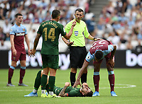 Football - 2019 Betway Cup (pre-season friendly) - West Ham vs. Athletic Bilbao<br /> <br /> West Ham United's Sebastien Haller checks on Athletic Club's Unai Nunez as Dani Garcia gestures for a yellow card to Referee Michael Oliver, at The London Stadium.<br /> <br /> COLORSPORT/ASHLEY WESTERN