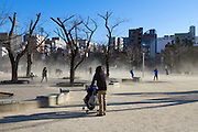 Wind blows dust across Sumiyoshi Park, Sumiyoshi, Tokyo, Japan. Thursday January 5th 2017