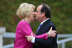 © Licensed to London News Pictures. 21/07/2016. Dublin, Ireland.  French President Francois Hollande kisses Sabina Higgins, wife of President Michael D Higgins at the end of a one day visit to Ireland in which he met with Irish President Michael D Higgins and Taoiseach Enda Kennny.  Photo credit: Paul McErlane/LNP