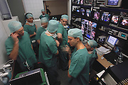 Video control room of (closed-circuit) televised cardiac conference in Leipzig, Germany enabling surgeons to view the latest techniques during live parallel surgical procedures which are transmitted to a nearby hotel conference center for viewing on huge screens by doctors attending the conference.