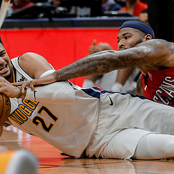 Dec 6, 2017; New Orleans, LA, USA; Denver Nuggets guard Jamal Murray (27) and New Orleans Pelicans center DeMarcus Cousins (0) scramble for a loose ball during the second half at the Smoothie King Center. The Pelicans defeated the Nuggets 123-114. Mandatory Credit: Derick E. Hingle-USA TODAY Sports
