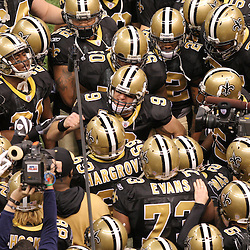 16 January 2010:  New Orleans Saints quarterback Drew Brees (9) leads his team in a pre game huddle prior to kickoff against the Arizona Cardinals for the 2010 NFC Divisional Playoff game at the Louisiana Superdome in New Orleans, Louisiana.