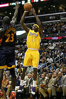 11 April 2006: Guard Smush Parker of the Los Angeles Lakers shoots a jumpshot over Jason Richardson of the Golden State Warriors against the Los Angeles Lakers during the fourth period of the Lakers 111-100 victory over the Warriors at the STAPLES Center in Los Angeles, CA.