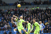 Huddersfield Town striker Harry Bunn (17) and Brighton central midfielder, Dale Stephens (6) jump for the ball during the Sky Bet Championship match between Brighton and Hove Albion and Huddersfield Town at the American Express Community Stadium, Brighton and Hove, England on 23 January 2016. Photo by Geoff Penn.