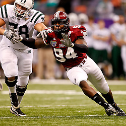 December 18, 2010; New Orleans, LA, USA; Troy Trojans defensive end Jonathan Massaquoi (94) rushes past Ohio Bobcats offensive linesman Joe Flading (78) during the first half of the 2010 New Orleans Bowl at the Louisiana Superdome.  Mandatory Credit: Derick E. Hingle