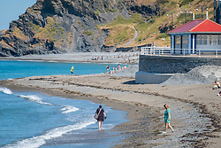 &copy; Licensed to London News Pictures<br /> 02 July 2018 . Aberystwyth Wales UK<br /> <br /> UK Weather:  People head to the seaside in Aberystwyth as the scorchingly hot  and very dry weather continues to dominate the UK.<br /> After a brief respite overnight, with some light rain, the searing heat has returned , with temperatures  again rising to the low 30&ordm;&rsquo;s this week<br /> <br /> photo credit&nbsp;Keith Morris / LNP