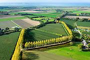 Nederland, Zeeland, Gemeente Borsele, 19-10-2014;  Zak van Zuid-Beveland, omgeving Ovezande. Westerschelde in de achtergrond. Kleinschalig landschap van binnendijken en kleine polders, 'oudland'. Boomgaarden en windsingels.<br /> Old Polders and ancient hedges in Zealand, Southwest Netherlands.<br /> luchtfoto (toeslag op standard tarieven);<br /> aerial photo (additional fee required);<br /> copyright foto/photo Siebe Swart