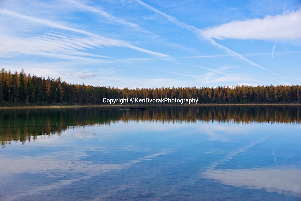 Clearwater Lake is in the Seeley Valley in western Montana, It is a mid-elevation mountain lake. Tamaracks surround the lake and turn gold in the fall.