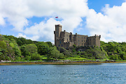 Ancient highland fortress Dunvegan Castle, the Highlands ancestral home of the MacLeod clan, by Dunvegan Loch a sea loch on the Isle of Skye in Scotland