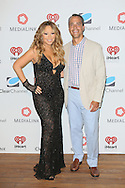 CAP D'ANTIBES, FRANCE - JUNE 17:  Mariah Carey and Tim Castelli, Clear Channel President of National Sales, Marketing and Partnerships attend Clear Channel Media And Entertainment And MediaLink Dinner at Hotel du Cap-Eden-Roc on June 17, 2014 in Cap d'Antibes, France.  (Photo by Tony Barson/Getty Images for Clear Channel)