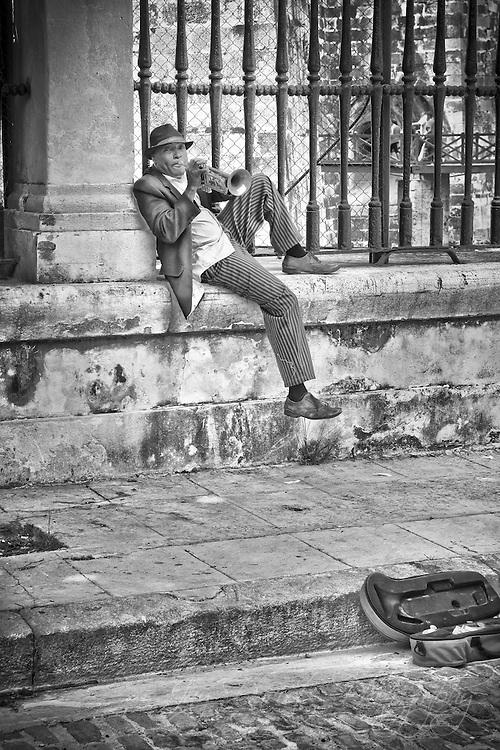 A street performer in Havana, Cuba plays some blues.