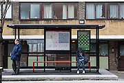 A vulnerable teenage youth ata bus stop on a Hackney estate, London. UK