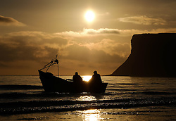 © Licensed to London News Pictures. <br /> 18/08/2016. <br /> Satburn-By-The-Sea, UK.  <br /> <br /> The crew of the fishing boat 'Ellen' head out from the beach to check their lobster and crab pots as the sun rises over Saltburn-By-The-Sea.<br /> <br /> Photo credit: Ian Forsyth/LNP