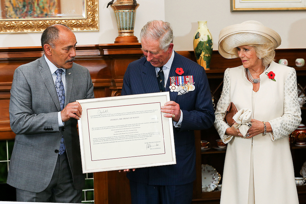 Governor-General Sir Jerry Mateparae, left, presents Prince Charles, Prince of Wales with his new Military Warrants while Camilla, Duchess of Cornwall looks on at Government House, Wellington, New Zealand, Wednesday, November 04, 2015. Credit:SNPA / Getty, Hagen Hopkins **POOL**