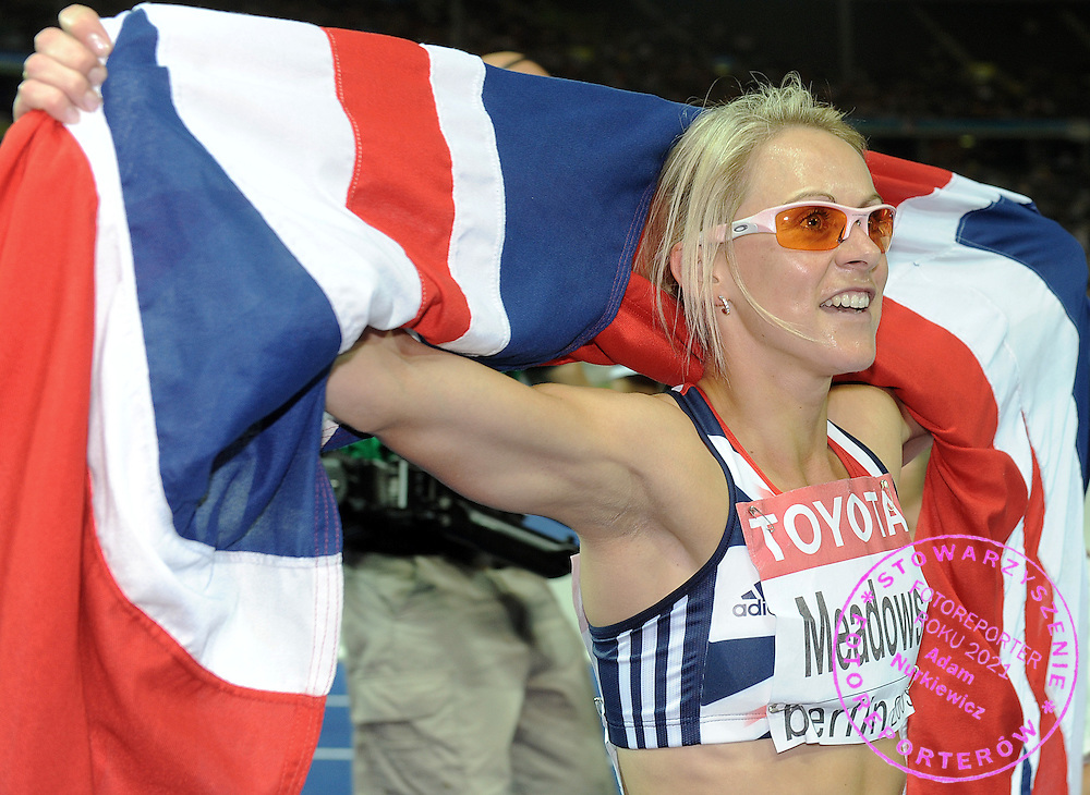 JENNIFER MEADOWS (GREAT BRITAIN) POSES WITH BRITISH FLAG AFTER 800 METERS RUN FINAL ON THE OLYMPIC STADION ( OLIMPIASTADION ) DURING 12TH IAAF WORLD CHAMPIONSHIPS IN ATHLETICS BERLIN 2009.SHE TOOK THE BRONZE MEDAL..BERLIN , GERMANY , AUGUST 19, 2009..( PHOTO BY ADAM NURKIEWICZ / MEDIASPORT )..PICTURE ALSO AVAIBLE IN RAW OR TIFF FORMAT ON SPECIAL REQUEST.