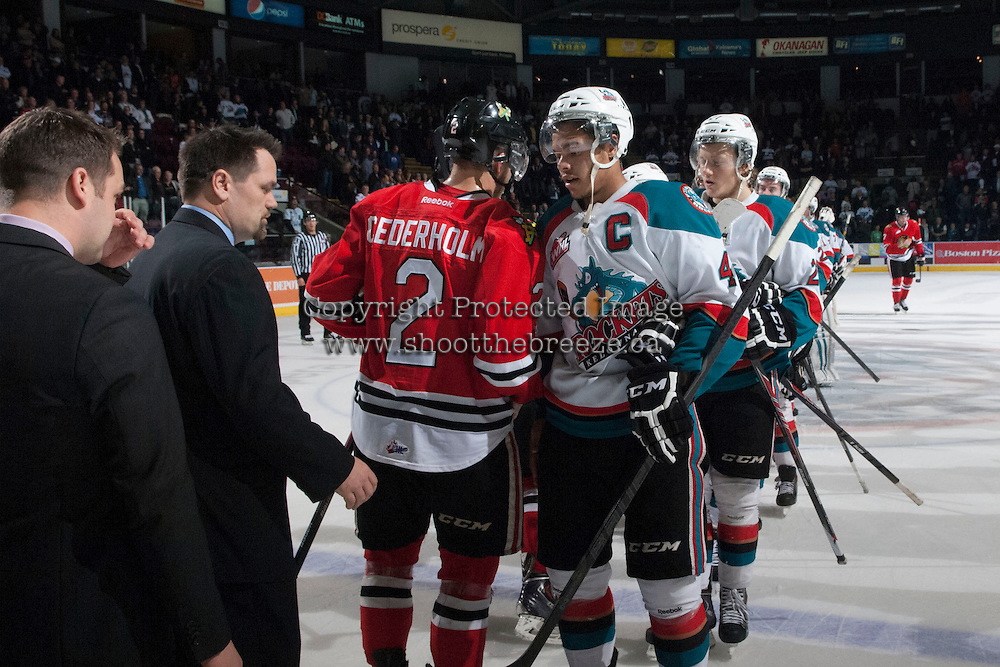 KELOWNA, CANADA - APRIL 25: Madison Bowey #4 of the Kelowna Rockets shakes hands with the Portland Winterhawks on April 25, 2014 during Game 5 of the third round of WHL Playoffs at Prospera Place in Kelowna, British Columbia, Canada. The Portland Winterhawks won 7 - 3 and took the Western Conference Championship for the fourth year in a row earning them a place in the WHL final.  (Photo by Marissa Baecker/Getty Images)  *** Local Caption *** Madison Bowey;