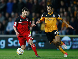 Bristol City's Sam Baldock takes on Hull's Ahmed Elmohamady- Photo mandatory by-line: Matt Bunn/JMP  - Tel: Mobile:07966 386802 19/04/2013 - Hull City v Bristol City - SPORT - FOOTBALL - Championship -  Hull- KC Stadium