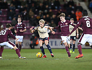 12th December 2017, Tynecastle Park, Edinburgh, Scotland; Scottish Premier League football,  Heart of Midlothian versus Dundee; Dundee's A-Jay Leitch-Smith is outnumbered by Hearts' Ross Callachan, Hearts' Harry Cochrane and Hearts' Prince Buaben
