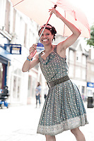 Vanessa Downie dancing in light rain in Wanstead High Street, part of the Angels of Wanstead series, photo Carole Edrich August 2, 2014