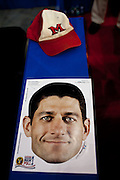 A mask of Rep. Paul Ryan sits next to a cap fromhis alma mater, Miami University at Ohio, at the Republican National Convention in Tampa, Florida, August 29, 2012.