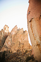 "A man climbing ""Scar Face"", a very difficult (5.13d) climbing route at Smith Rock, Oregon, USA."