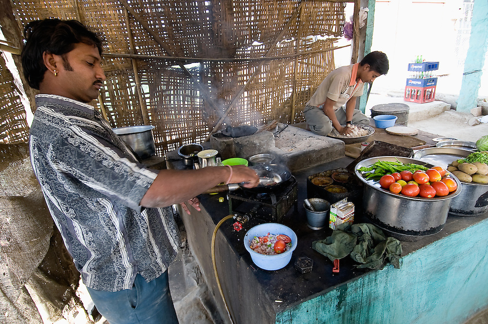 Two young man cooking a traditional Indian lunch in a 'dhabba', a roadstall (Rajasthan, India)