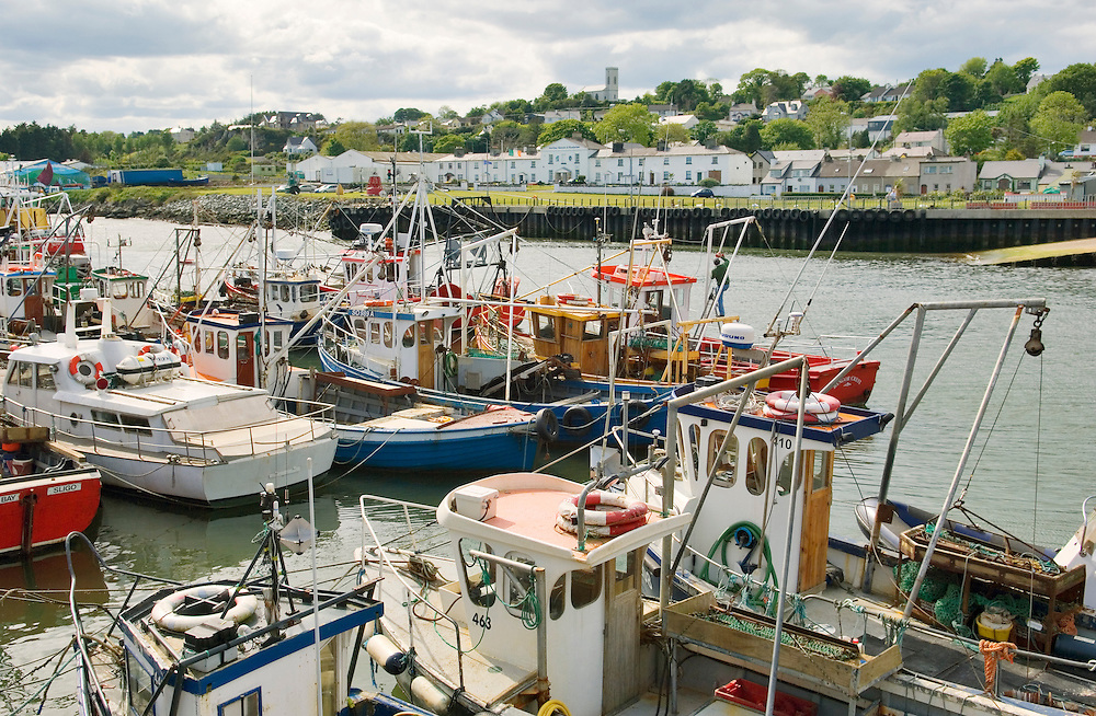 Fishing boats in the port harbour of Greencastle on the Inishowen shore of Lough Foyle in north Donegal, Ireland.