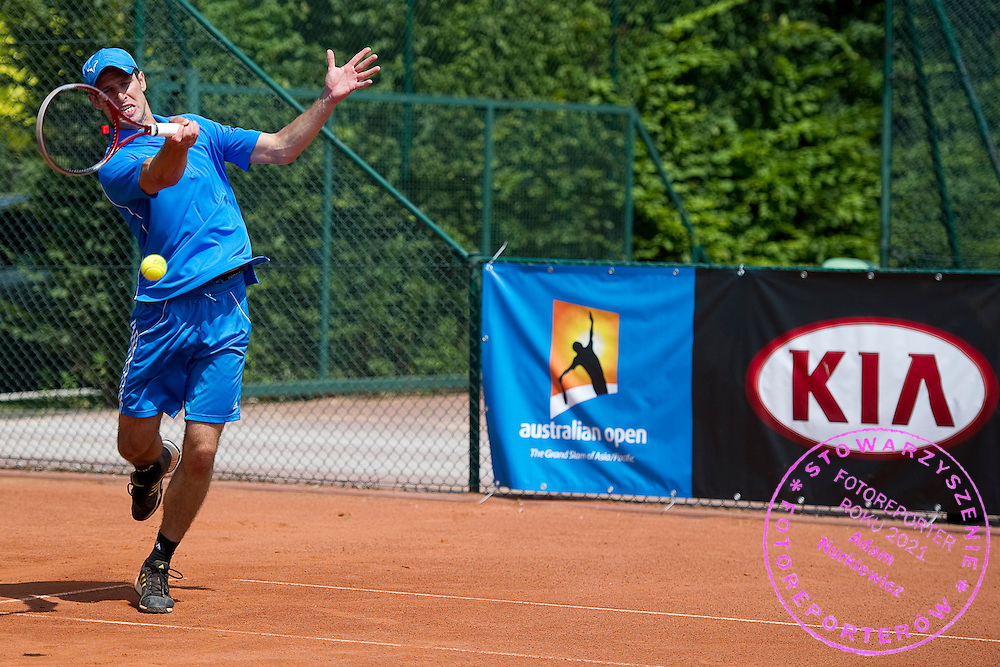 Tennis player competes in 29th Polish National Championships in Amateur Tennis on Warszawianka Courts in Warsaw, Poland.<br /> <br /> Poland, Warsaw, July 17, 2013<br /> <br /> Picture also available in RAW (NEF) or TIFF format on special request.<br /> <br /> For editorial use only. Any commercial or promotional use requires permission.<br /> <br /> Photo by &copy; Adam Nurkiewicz / Mediasport