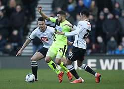 Nahki Wells of Huddersfield Town (C) in action against Thomas Ince (R) and Jason Shackell of Derby County - Mandatory byline: Jack Phillips/JMP - 05/03/2016 - FOOTBALL - iPro Stadium - Derby, England - Derby County v Huddersfield Town - Sky Bet Championship