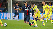 Paris Saint-Germain Zlatan Ibrahimović (vice captain) battles with Chelsea's Gary Cahill during the Champions League match between Paris Saint-Germain and Chelsea at Parc des Princes, Paris, France on 17 February 2015. Photo by Phil Duncan.