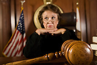 Female judge pondering over sentence
