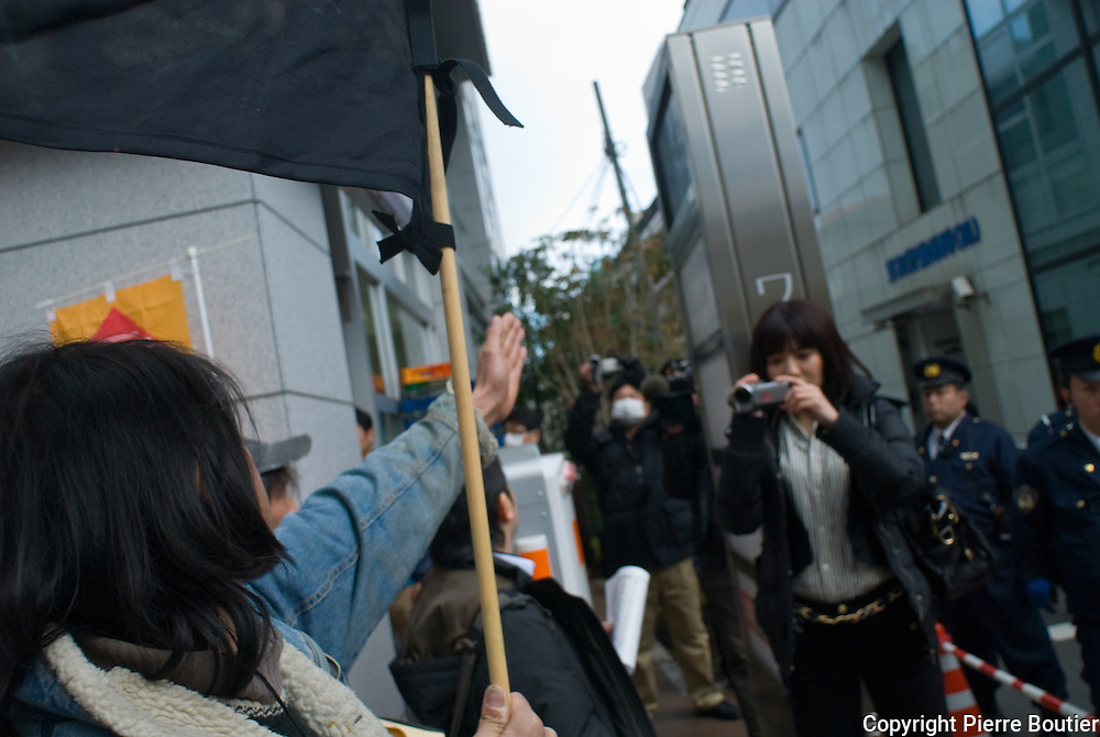 """Tokyo 25 december """"Reality"""" Rally to protest front of appartement of Mr Katsumata president of Tepco,one hundred of protesters read letters and reclaim indemnity for the victims of nuclear catasrophy"""