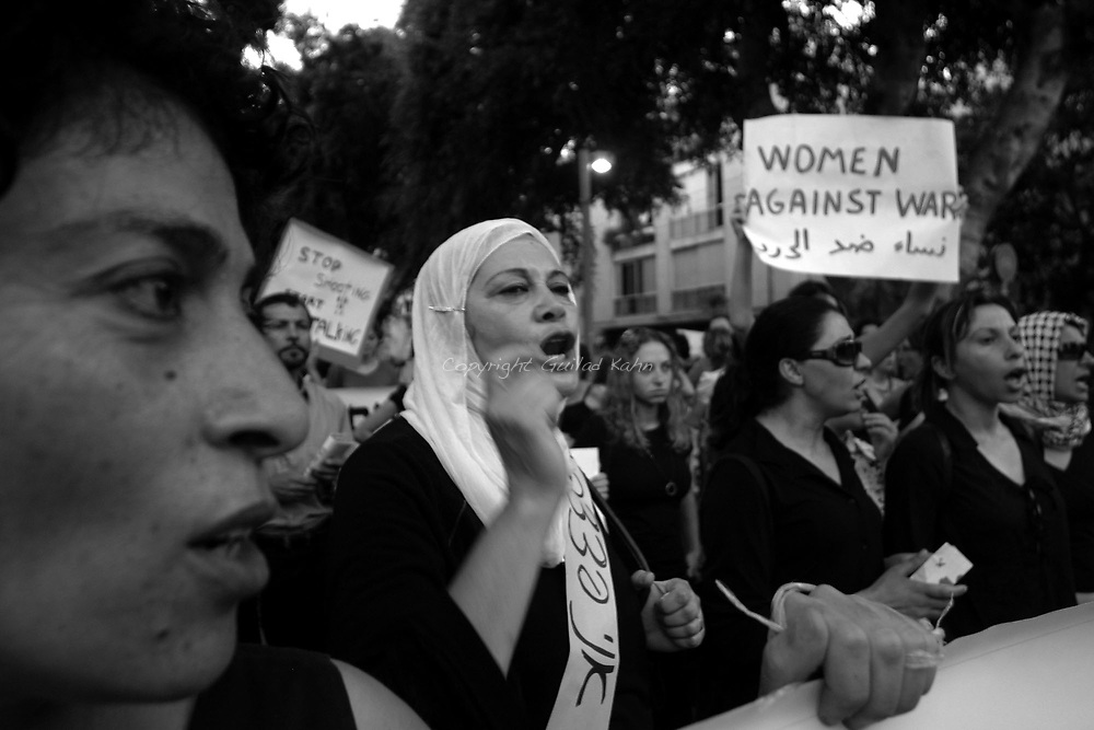 """various left wing arab and jewish women organizations and the """"anarchists against the wall"""" staged an anti war demonstration march in Tel aviv on  Saturday, July 29th 2006. protesting against the Israeli incursion into Lebanon and the ongoing violence against civilians in Gaza.."""