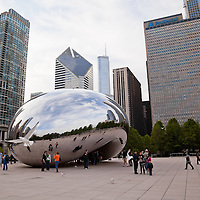 Chicago bean Cloud Gate sculpture with people enjoying a spring day at Millenium Park