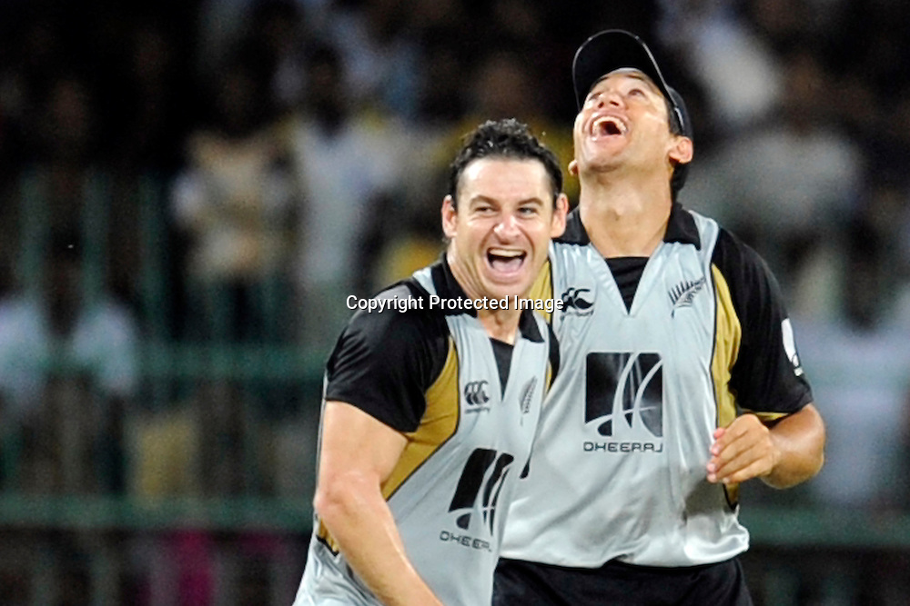 Nathan McCullum and Ross Taylor celebrate.<br />New Zealand celebrate winning the Twenty20 series 2-0.<br />2nd Twenty20, Sri Lanka, 4 September 2009. Photo: Thusith Wijedoru/PHOTOSPORT