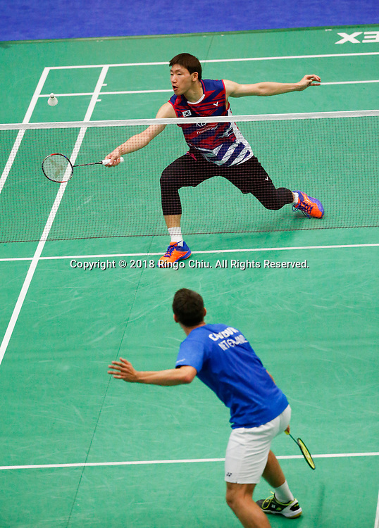 Lee Dong Keun (top) of Korea, competes with Mark Caljouw of Netherland, during the men's singles final match at the U.S. Open Badminton Championships in Fullerton, California, on June 17, 2018. Lee won 2-1. (Photo by Ringo Chiu)<br /> <br /> Usage Notes: This content is intended for editorial use only. For other uses, additional clearances may be required.