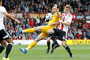 Brentford midfielder Lewis Macleod (4) fouls Preston North End defender Greg Cunningham (3) during the EFL Sky Bet Championship match between Brentford and Preston North End at Griffin Park, London, England on 17 September 2016. Photo by Andy Walter.
