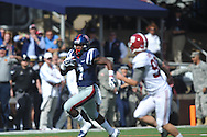 Mississippi Rebels' running back Mark Dodson (7) is chased by Alabama Crimson Tide place kicker Adam Griffith (99) on the opening kickoff at Vaught-Hemingway Stadium in Oxford, Miss. on Saturday, October 4, 2014. Ole Miss won 23-17.