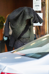Former Borderforce official Laura Hudson hides her face as she leaves an employment tribunal in Watford where she is arguing her case to be reinstated after being dismissed for failing to declare a relationship with a convicted criminal who is currently in prison for being found in possession with 2kg of cocaine after having served time for armed robbery. WATFORD, October 03 2018.